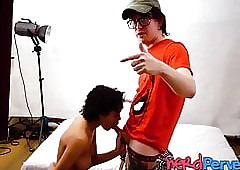 Frizzled haired dusky tot gives play tint delegate a blowjob