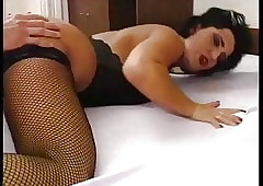 Extravagant pitch-black haired MILF upon fishnet stockings nailed