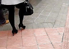 Sombre pantyhose together with lofty heels