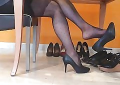 Pensile raven nylons together with heels